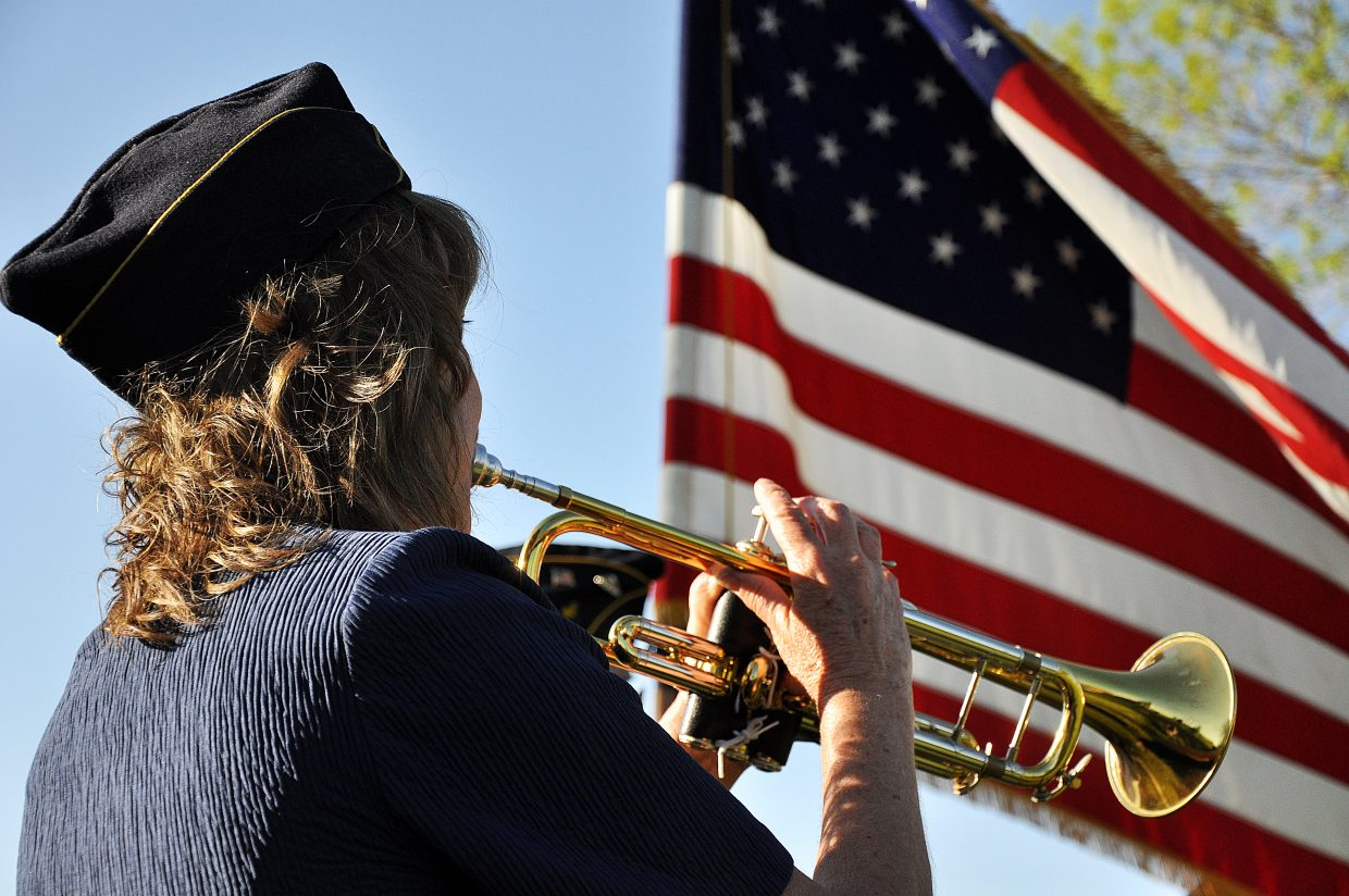 Christine Epp plays taps on the trumpet Monday during a Memorial Day service in Hayden.