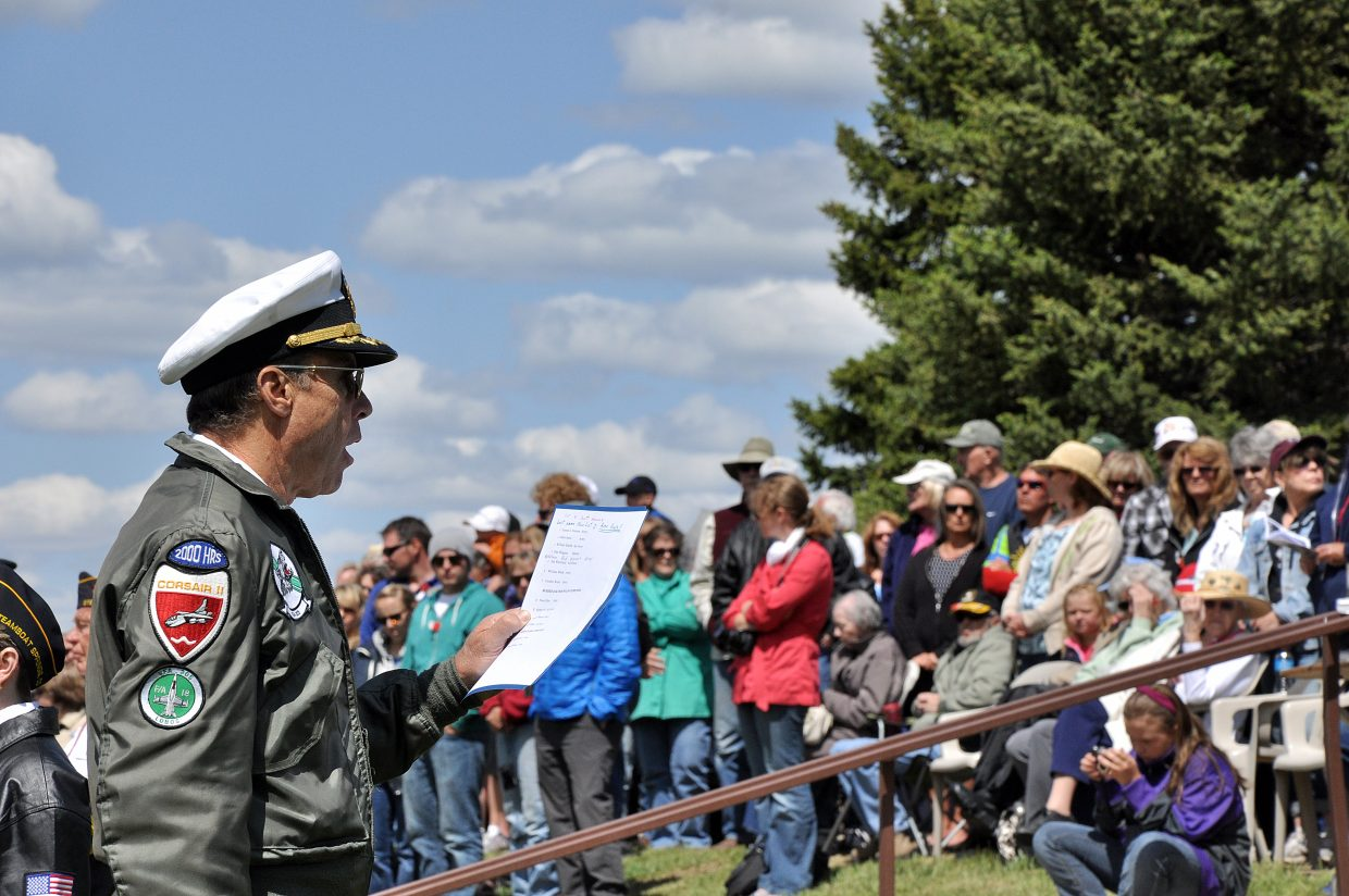 Veteran U.S. Navy pilot Scott Sanwick reads the names of deceased Vietnam and Cold War-era veterans Monday who are buried in Steamboat Springs area cemeteries.