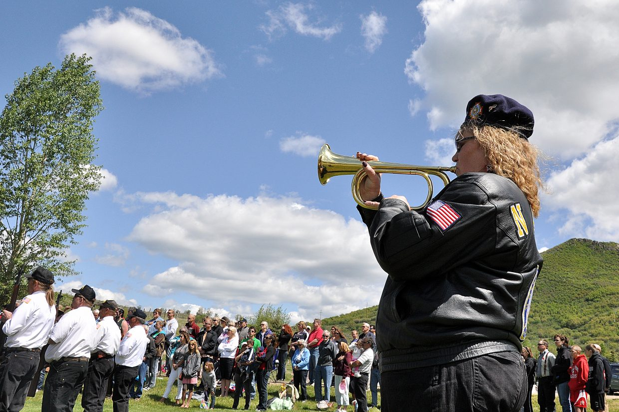 Valerie Bussey plays taps on a bugle Monday during a Memorial Day service in Steamboat Springs.