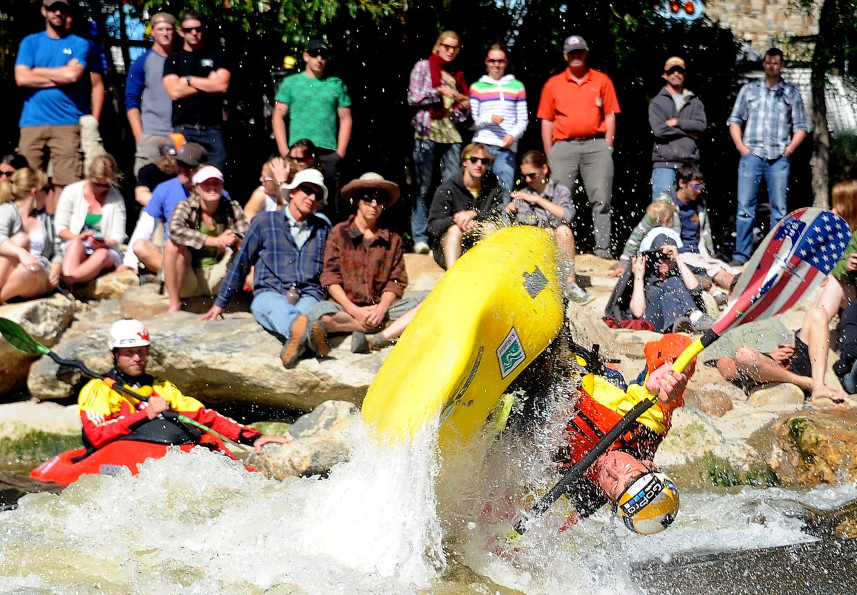 Dane Jackson flips in Charlie's Hole on Monday during the Paddling Life Pro Open in Steamboat Springs. He won the freestyle portion of the event and was second in the Fish Creek race, tying Nick Troutman for the overall title.