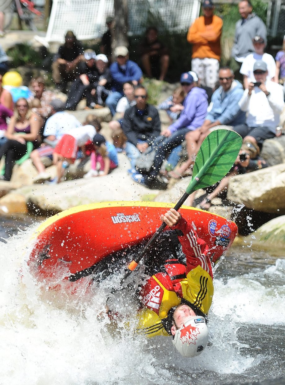 Nick Troutman flips in Charlie's Hole on Monday during the Paddling Life Pro Open in Steamboat Springs.