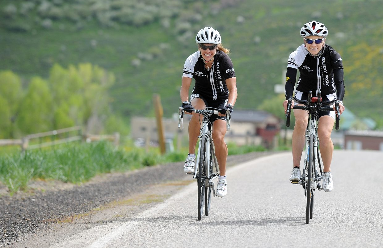 Heather Gollnick, left, and Lisa Renee Tumminello train Tuesday along Twentymile Road near Steamboat Springs. The two are part of a four-person team in the Race Across America beginning June 15.