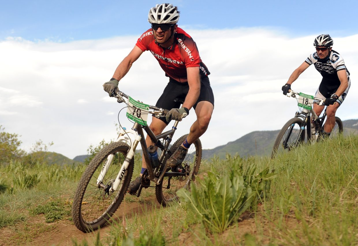 Sars Larson, left, and Gordon Watson ride in the Howlin' Howelsen in 2012. This year's race kicks off the Town Challenge Mountain Bike Race Series on Wednesday.