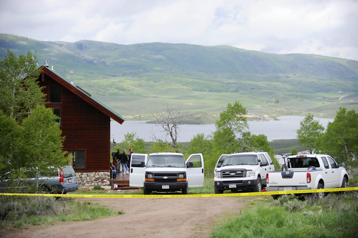 Routt County Coroner Rob Ryg is joined by investigators from the Routt County Sheriff's Office on Wednesday at the Stagecoach home where it is thought a mother shot and killed her 9-year-old son early Wednesday morning before turning the gun on herself.