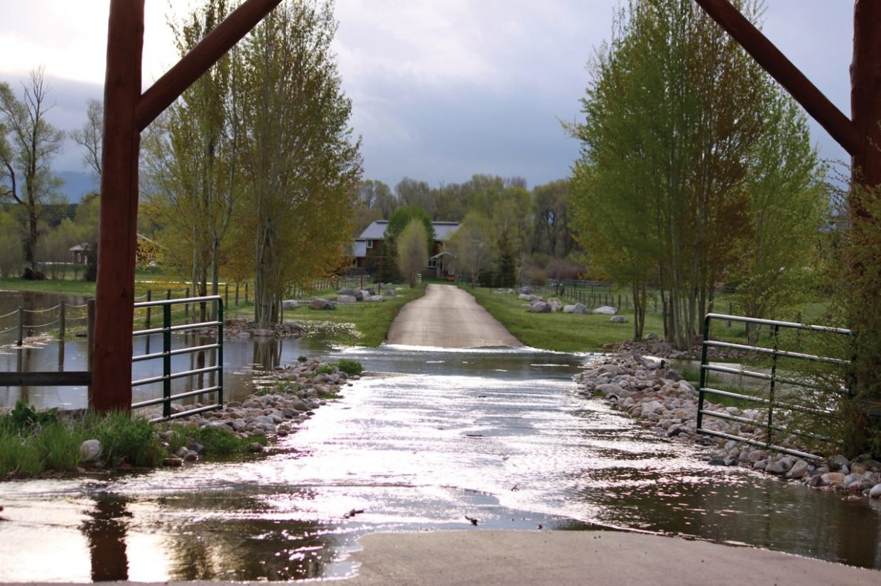 The flooded driveway of a home near the Elk River west of Steamboat Springs on Monday morning.