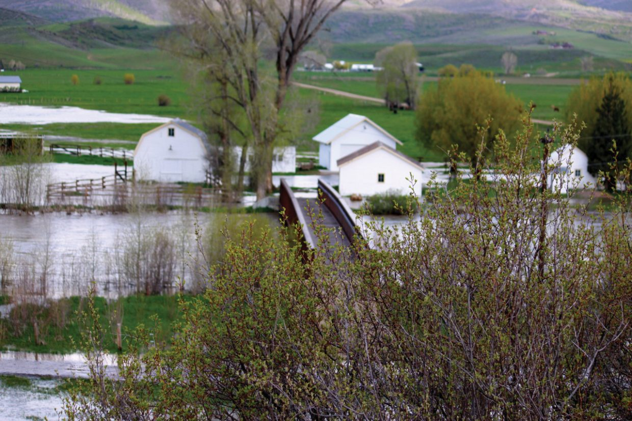 Floodwaters inundate a ranch west of Steamboat Springs on Monday. The Elk River reached flood stage early Monday morning.