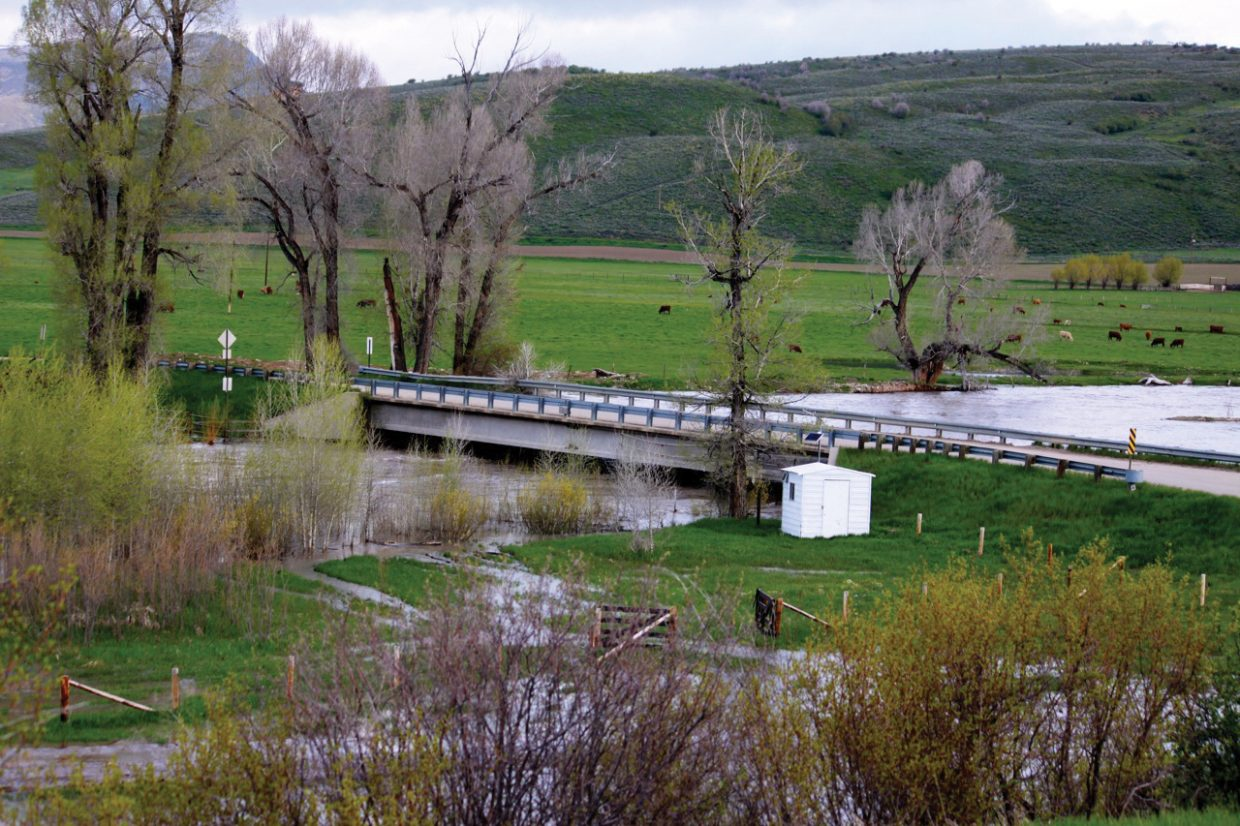 The Elk River makes its way under the U.S. Highway 40 underpass near its confluence with the Yampa River on Monday morning.