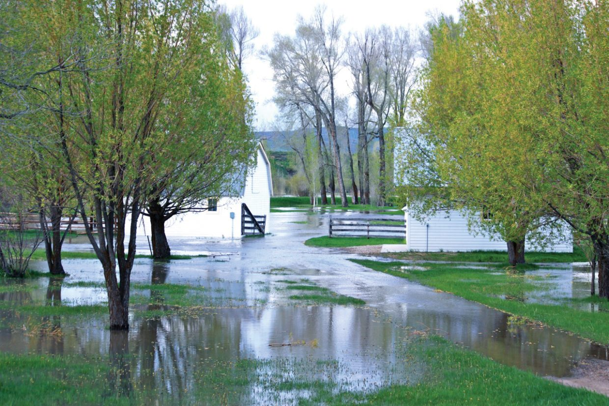 A flooded property adjacent to the Elk River west of Steamboat Springs on Monday.