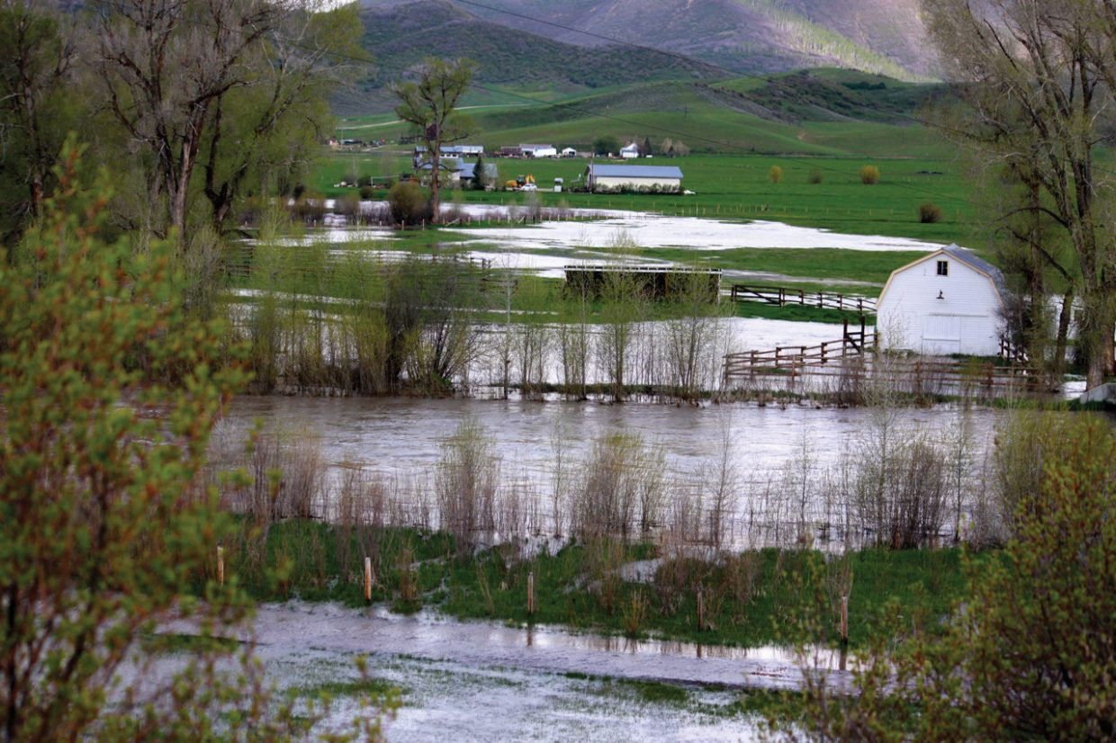The Elk River, center of picture, topped its banks Monday morning west of Steamboat Springs.