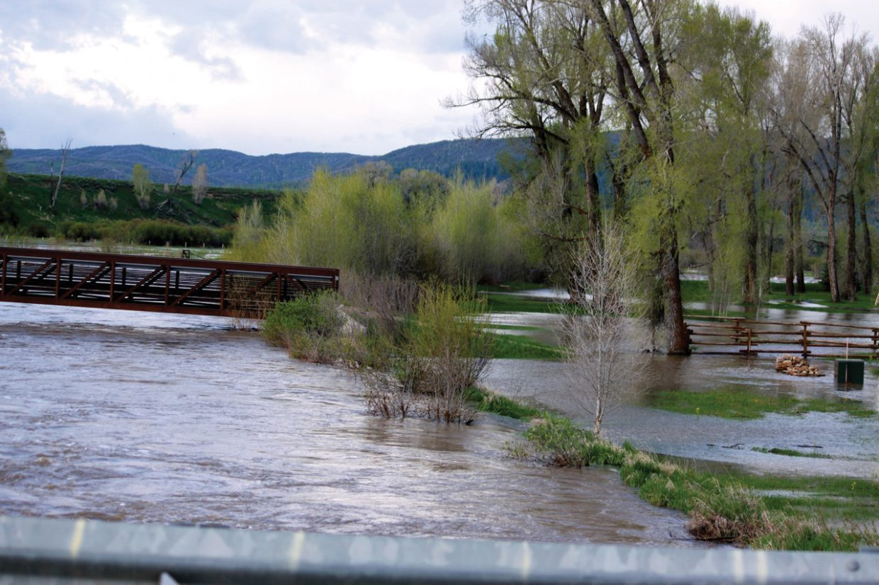Rapidly melting snow in the mountains surrounding Steamboat Springs pushed the Elk River beyond its banks Monday morning.