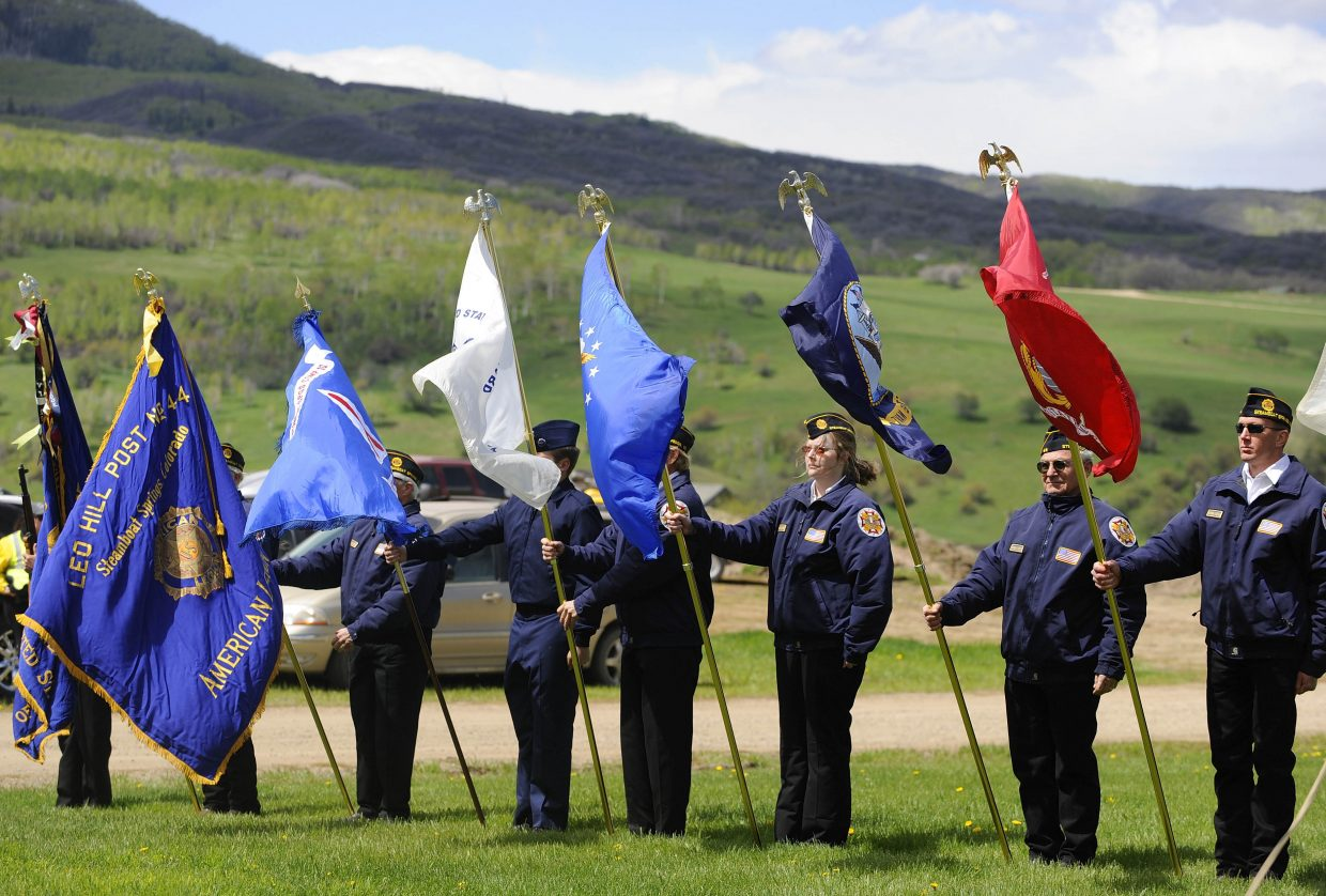 U.S. Air Force veteran Stacey Anderson (third from right) is joined by other service members during Monday's Memorial Day ceremony at Steamboat Springs Cemetery. Women were recognized for their service during this year's ceremony.