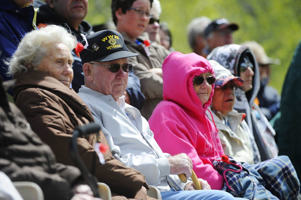 Former Steamboat Springs resident and World War II Army veteran Wayne Ehle sits with his wife, Becky Ehle, left, during Monday's Memorial Day ceremony at Steamboat Springs Cemetery.