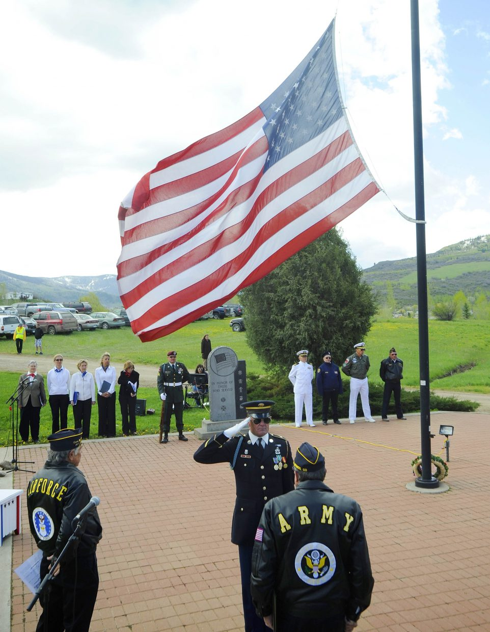 Rick Reinhard salutes fellow veterans during Monday's Memorial Day ceremony at Steamboat Springs Cemetery.