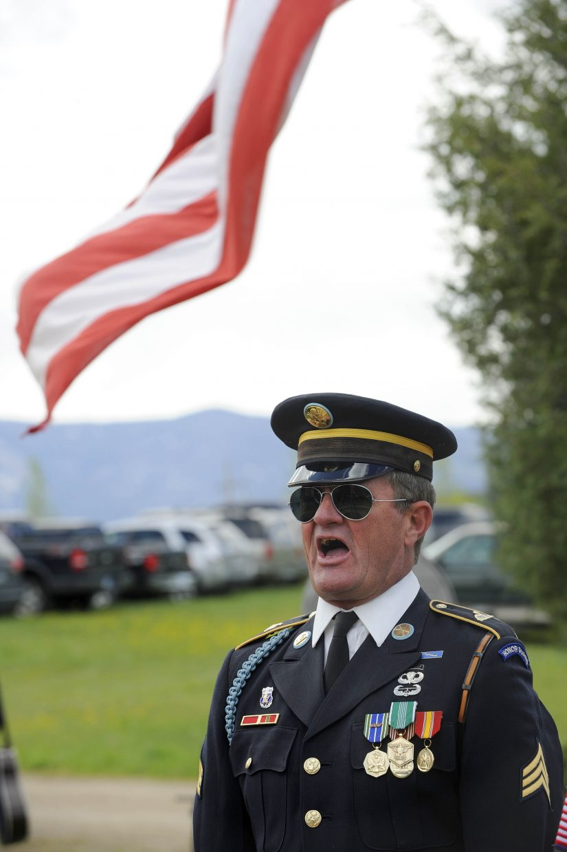 Rick Reinhard gives orders during Monday's Memorial Day ceremony at Steamboat Springs Cemetery.