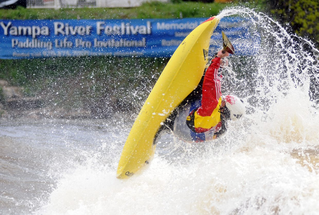 Nick Troutman flies through a trick Monday during the finals of the Paddling Life Pro Kayaking Invitational in Steamboat Springs. Troutman won the freestyle competition but lost the overall title as 17-year0old Dane Jackson, Troutman's brother-in-law, proved nearly as good on the freestyle wave a few seconds better in the morning's Fish Creek whitewater race.