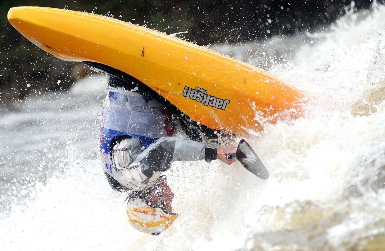 Dane Jackson flips in the D Hole during the Paddling Life Pro Invitational in Steamboat Springs. He won the event.