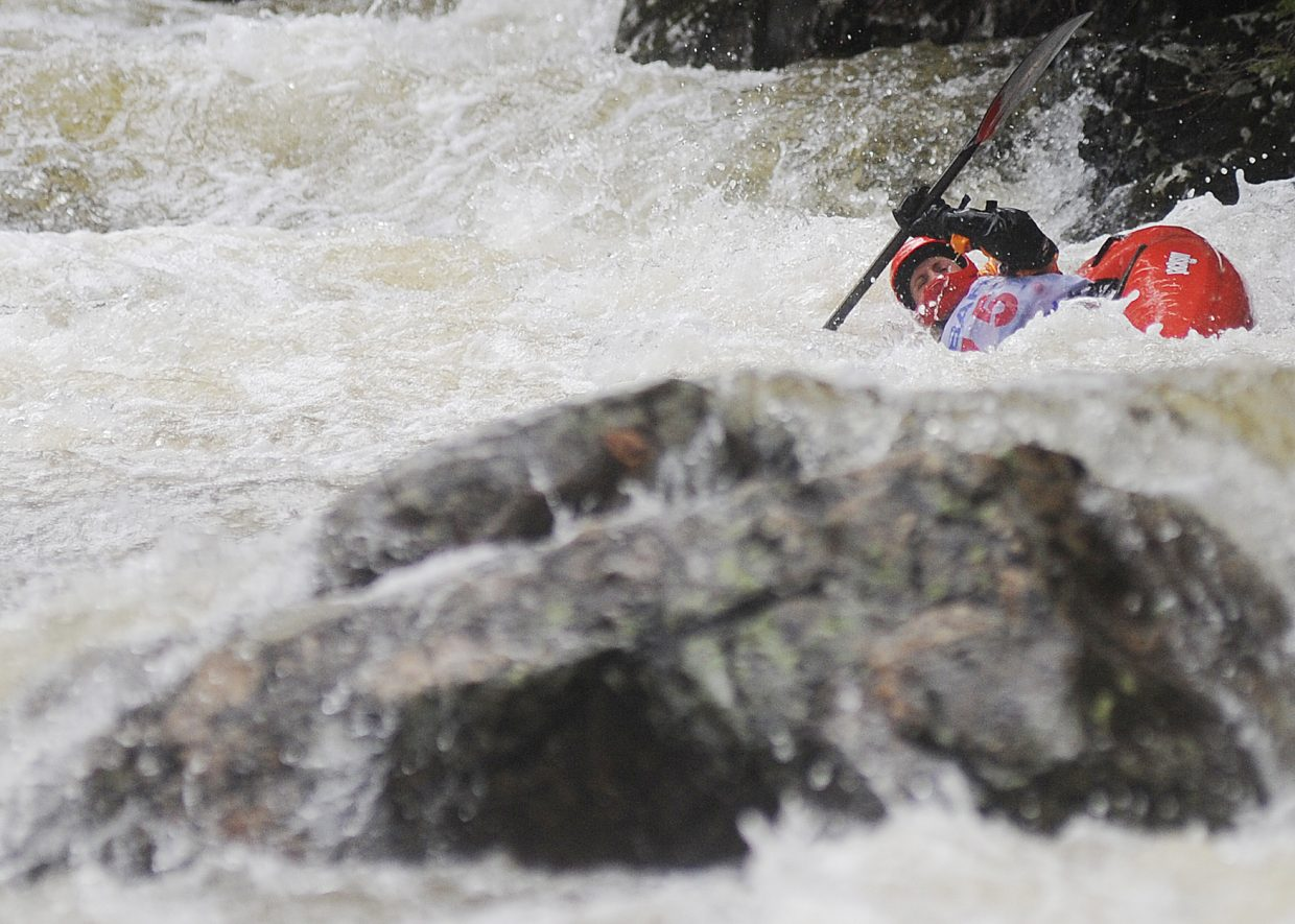 Ruth Ebens struggles to stay right-side-up Monday during the Fish Creek kayak race during the Paddling Life Pro Invitational in Steamboat Springs.