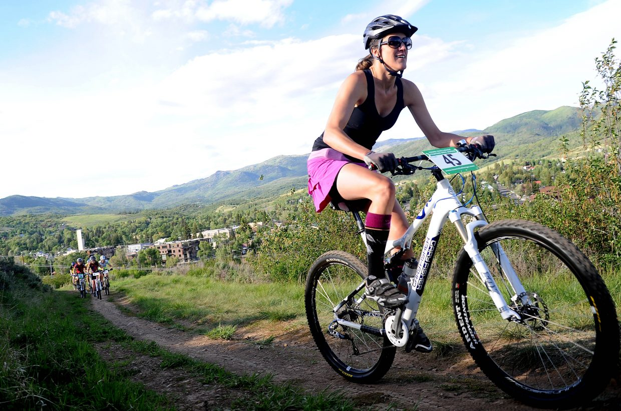 Gretchen Coleman leads a pack of riders early in Wednesday's Howlin' Howelsen race in Steamboat Springs. The season's first Town Challenge race attracted a large field.