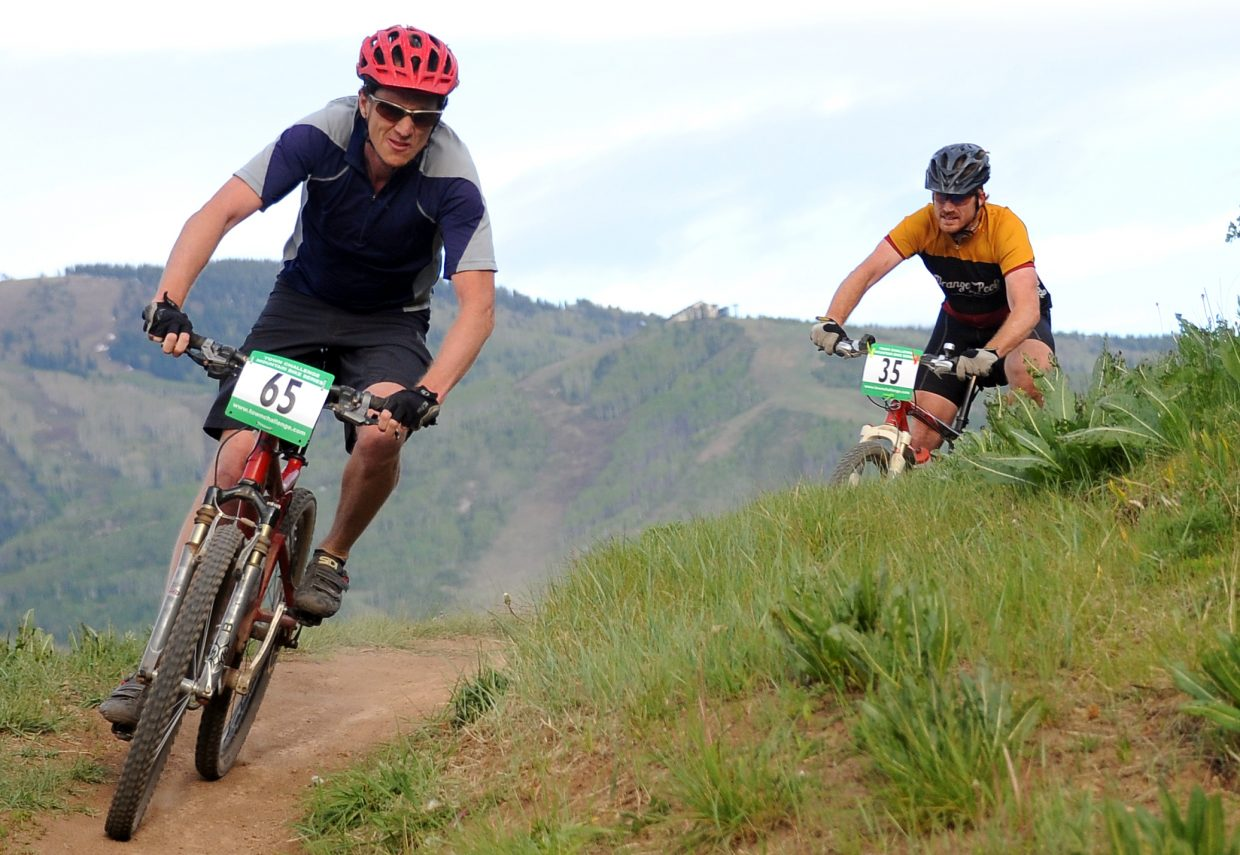 Dan Foote, left, and Tony Urbick rides Wednesday in a Town Challenge race at Howelsen Hill in Steamboat Springs.