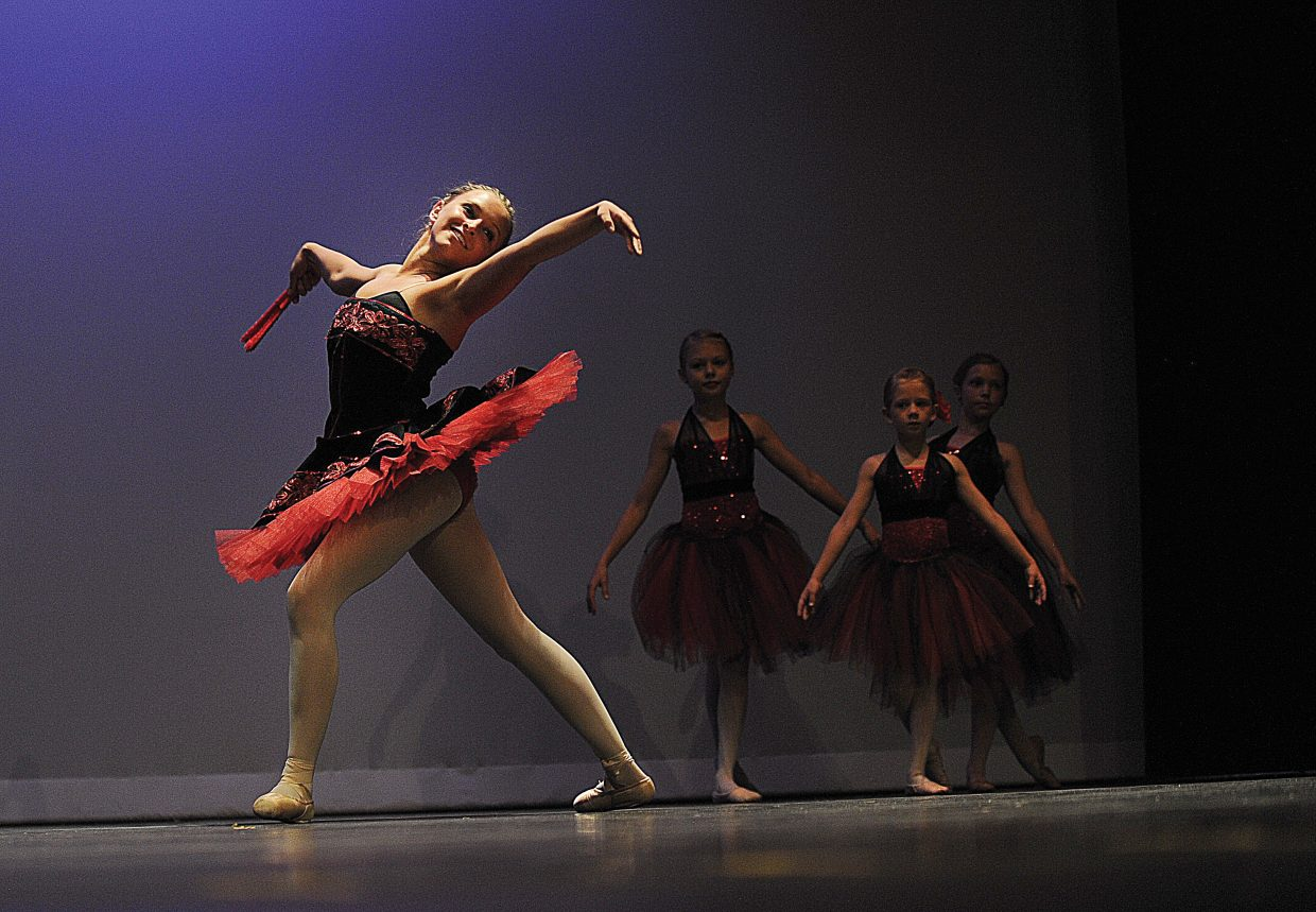 Dancer Maggie McElhiney performs Carmen with the ballet 2 class during a dress rehearsal for Elevation Dance Studio's annual recital, which will take place at 6 p.m. Friday and Saturday at the Steamboat Springs High School auditorium.