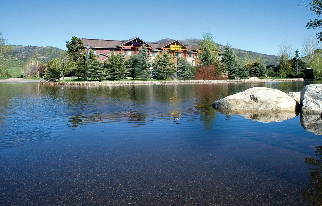 The parking lot in front of the Steamboat Hotel was filled with water Tuesday morning.