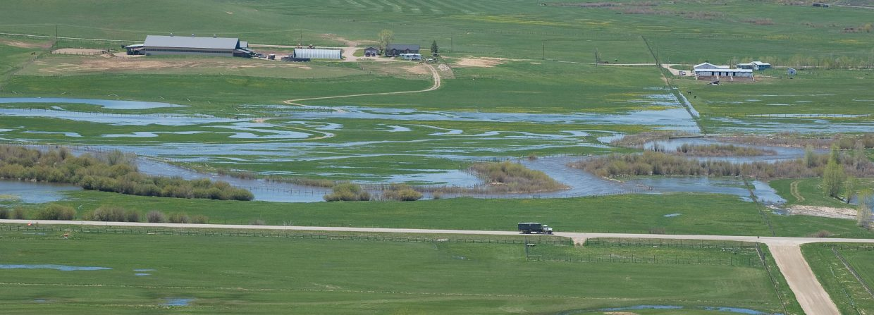 Fields in the Yampa Valley are already saturated with spring runoff, but could get event more water as snow on the higher peaks will begin to melt with warmer temperatures this week.