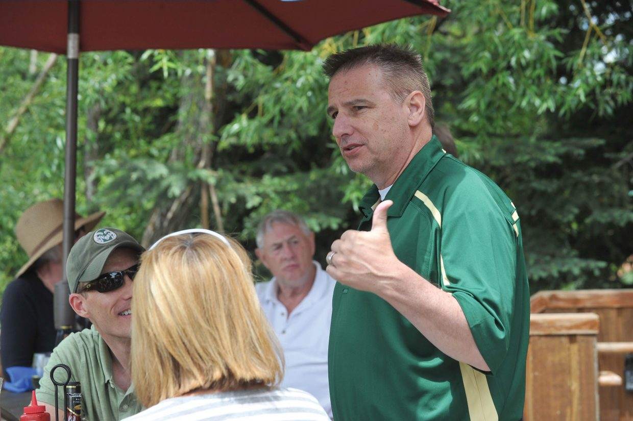 Colorado State head basketball coach Larry Eustachy speaks to a crowd at The Boathouse Pub on Thursday afternoon in Steamboat Springs.