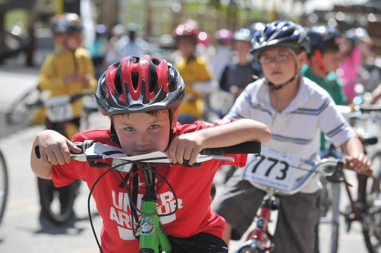 Second-grader Chance Reynolds waits for his turn on the obstacle course during Soda Creek Elementary School's Bike Rally on Friday morning. Students spent some of their day taking part in a bike-related activities at the school.