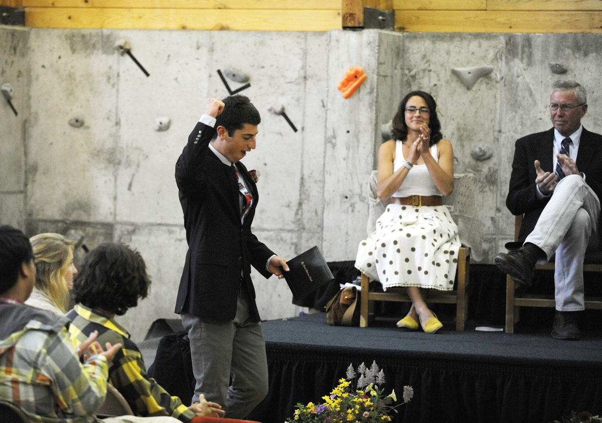 Seth Zegelstein reacts after receiving his diploma during The Lowell Whiteman School graduation ceremony Saturday.