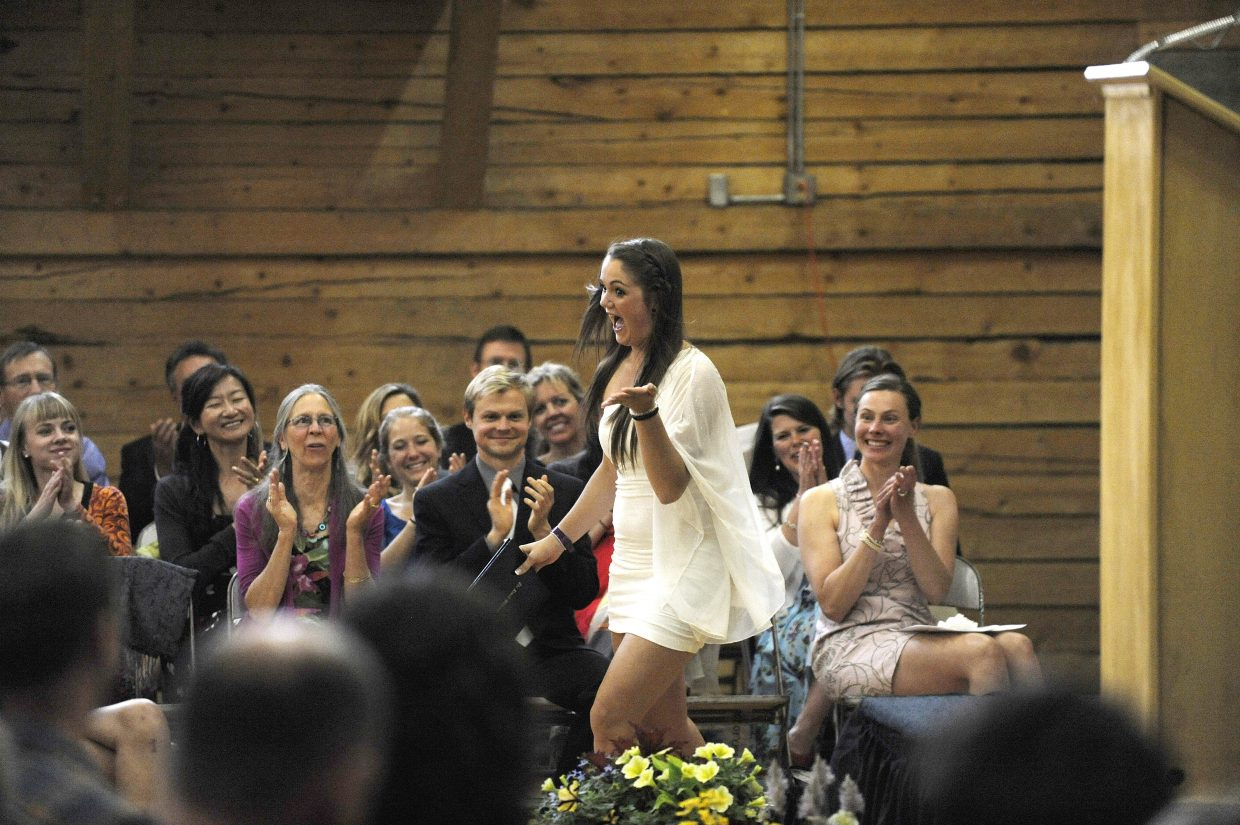 Nicole Stanley reacts after receiving her diploma during The Lowell Whiteman School graduation ceremony Saturday.