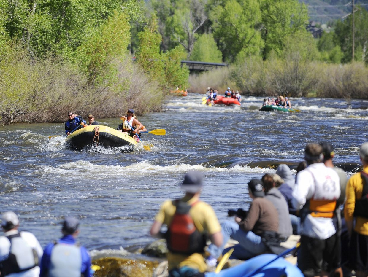 Rafts come down the Yampa River on Saturday during the Yampa River Festival raft race.