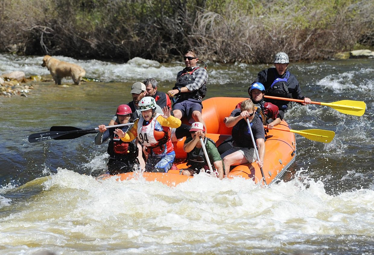 A team drops into Charlie's Hole on Saturday during the Yampa River Festival raft race.