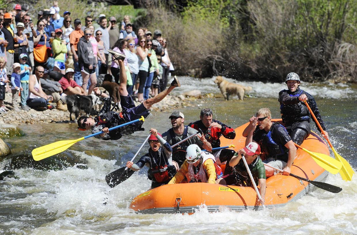 Soren Jespersen flies out of his team's boat on Saturday during the Yampa River Festival raft race.