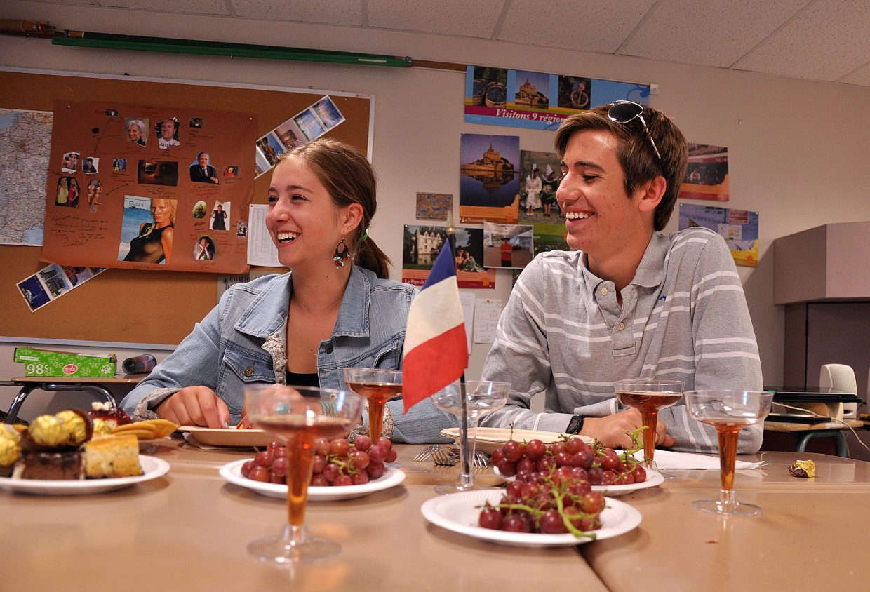 Steamboat Springs High School students Avery Globe, left, and Grant Verploeg enjoy an end-of-the-year party Wednesday during their French class. The Steamboat school district will evaluate its world languages program next school year.