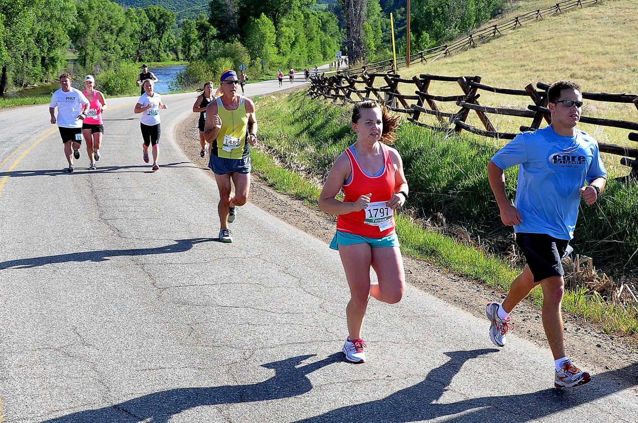 Runners head toward Steamboat Springs on Sunday during the Steamboat Marathon.