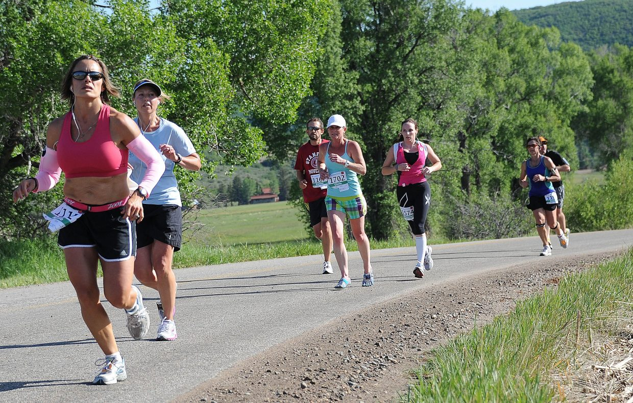 Mount Werner comes into sight as runners in the half marathon come around a corner on Sunday during the Steamboat Marathon.