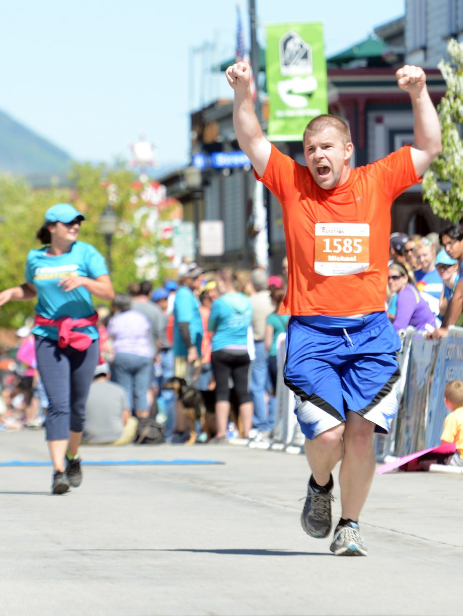 A half-marathon finisher couldn't contain his excitement as he approached the finish line Sunday at the Steamboat Marathon.