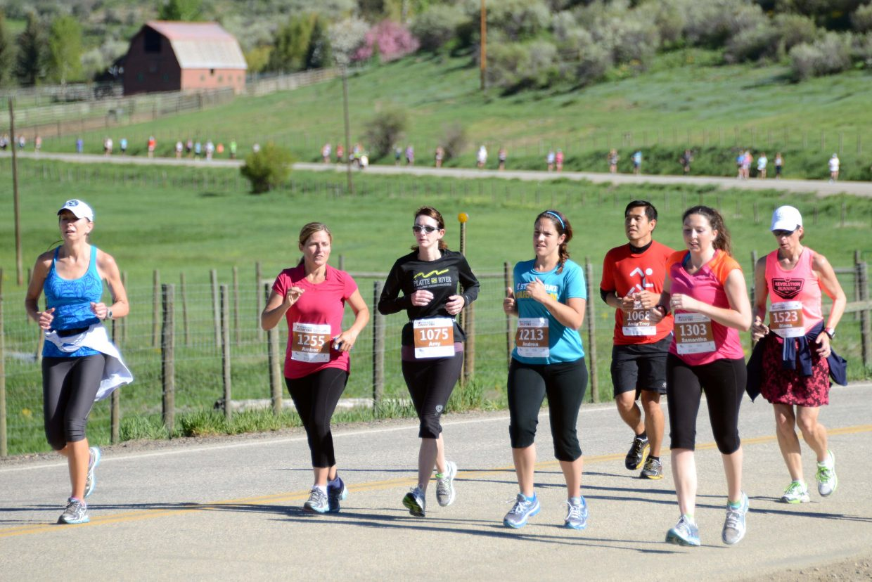 A long line of runners stream toward Steamboat Springs on Sunday during the annual Steamboat Marathon.
