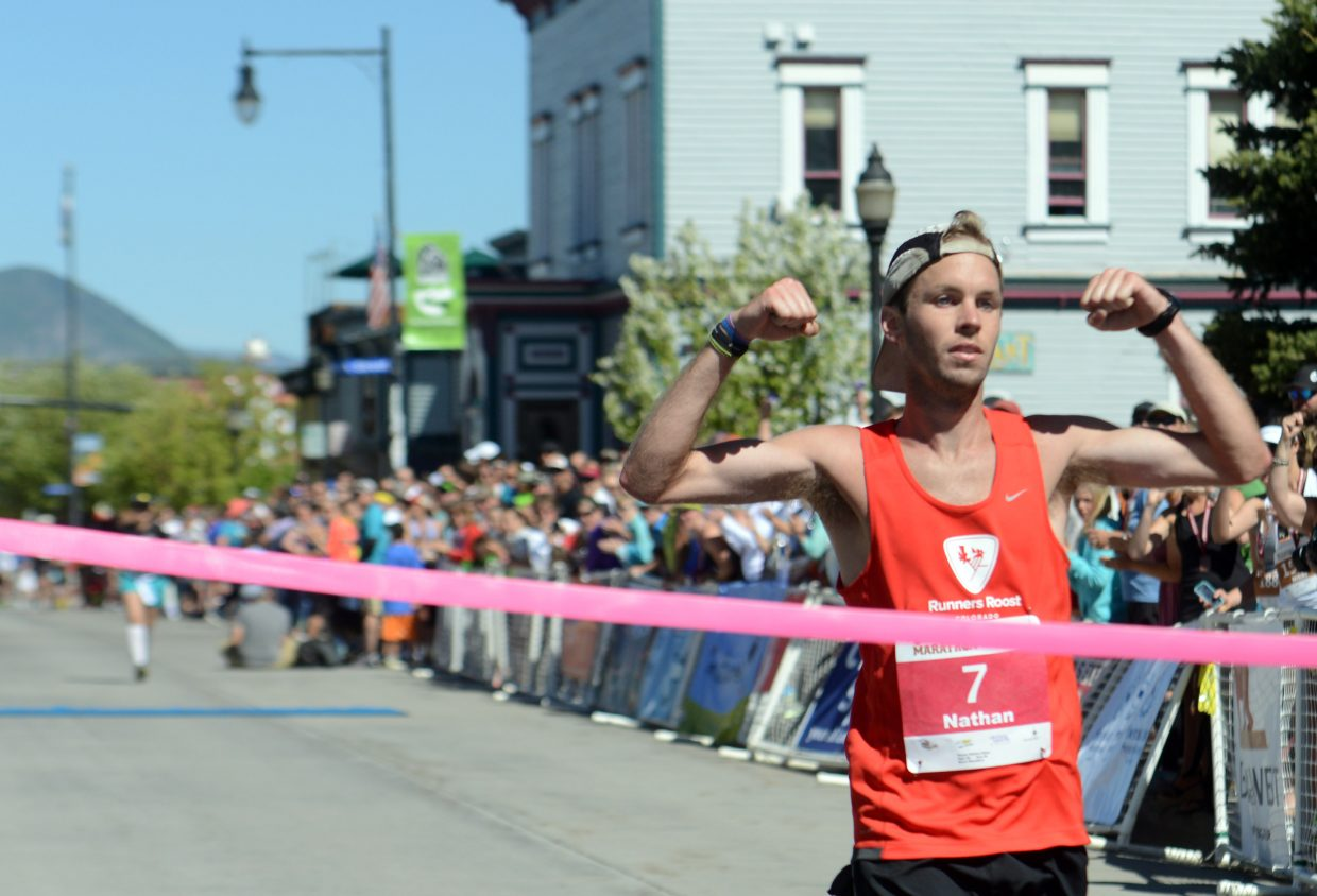 Steamboat's Nathan Allen crosses the finish line Sunday in the Steamboat Marathon. He won the race, his first attempt at the distance.