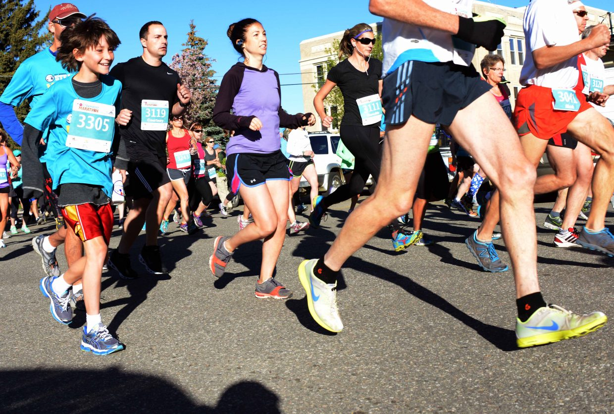 Racers head away from the starting line of the 10-kilometer race Sunday during the Steamboat Marathon.