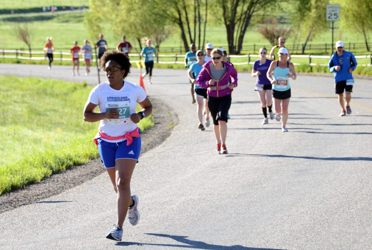 Runners in the 10-kilometer race head down the road Sunday in the Steamboat Marathon.