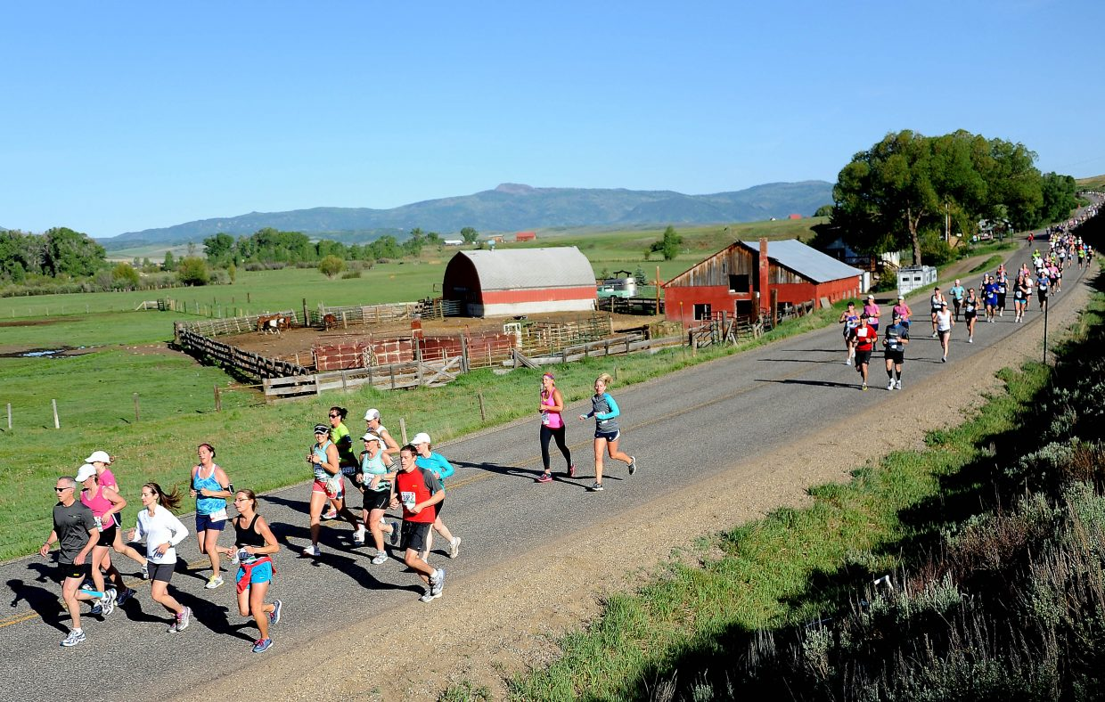 Runners stream toward Steamboat Springs on Sunday during the 31st annual Steamboat Marathon. The race had more than 1,400 finishers for its three distances.