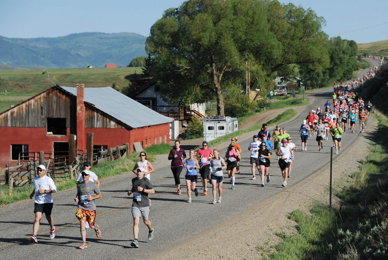 Participants run toward Steamboat Springs on Sunday during the Steamboat Marathon.