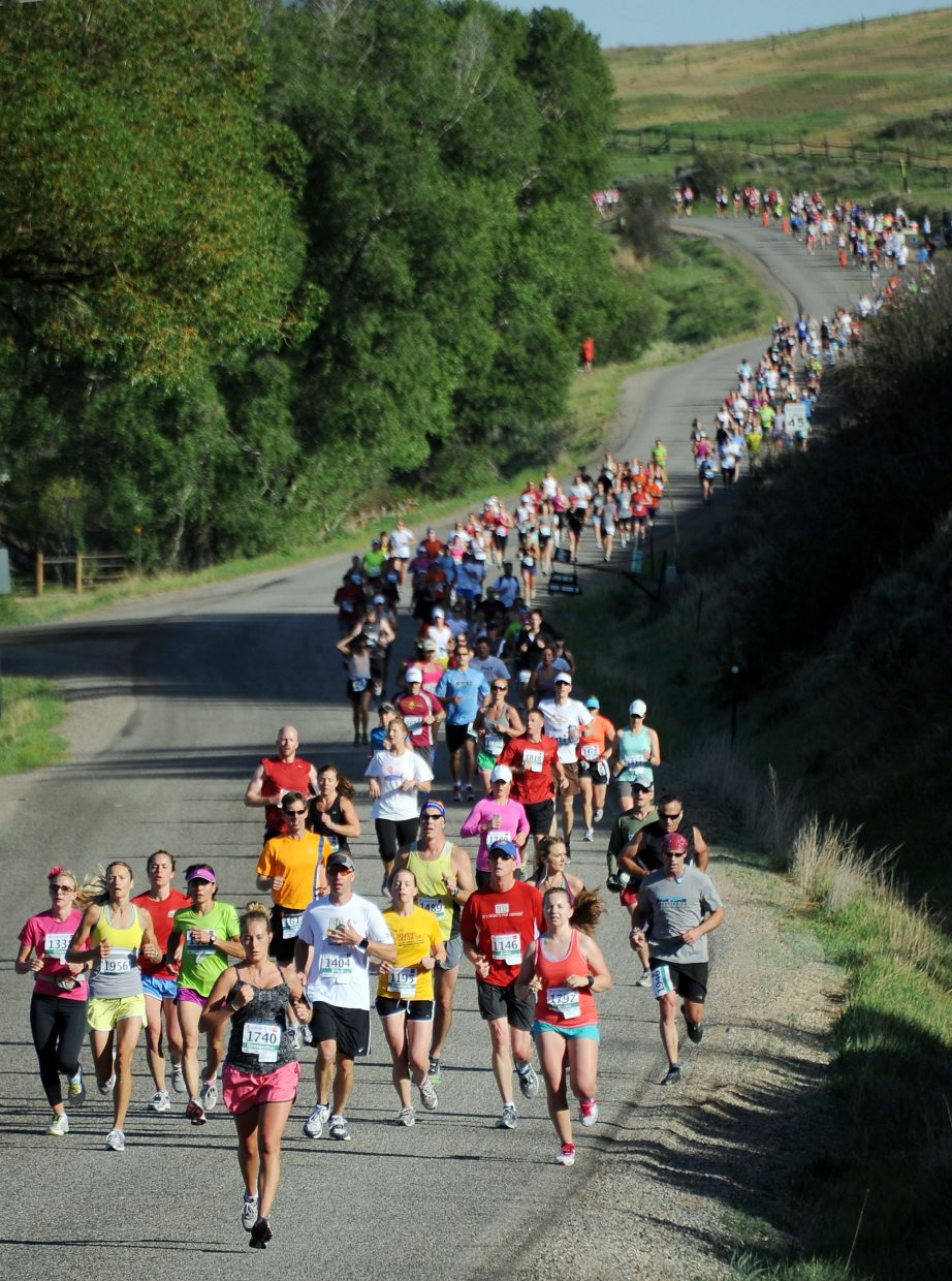Runners make their way toward Steamboat Springs on Sunday during the Steamboat Marathon.