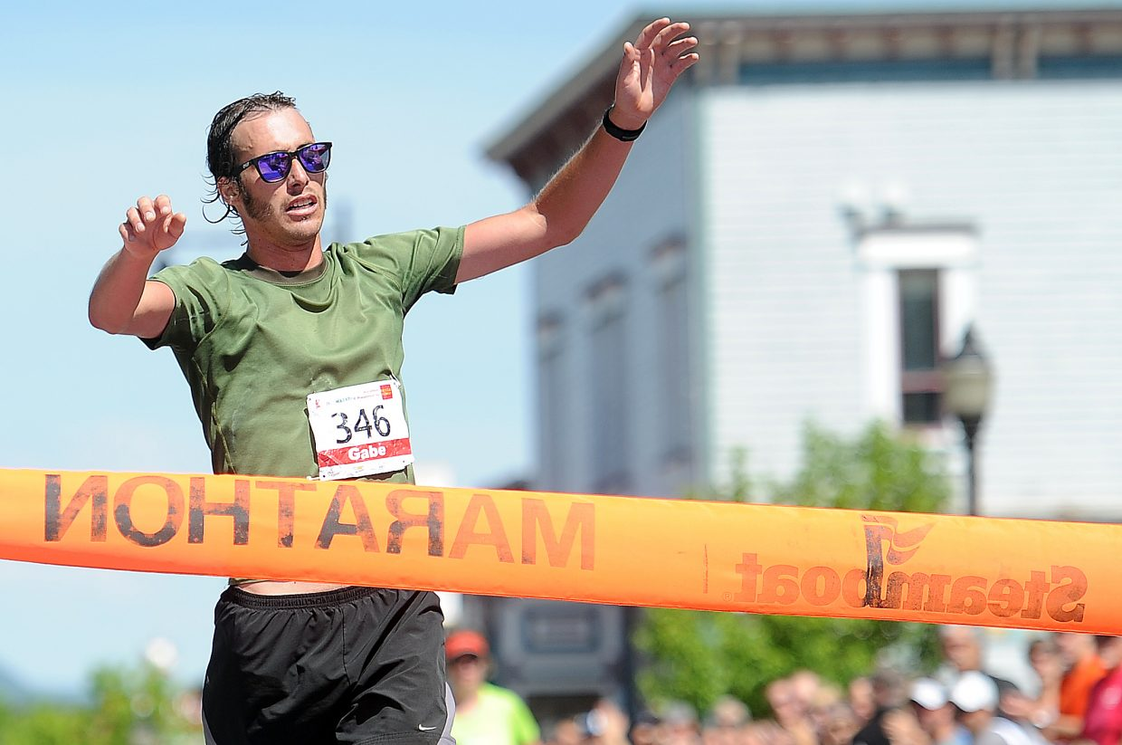 Gabe Small crosses the finish line Sunday. He won the Steamboat Marathon for the second consecutive year.