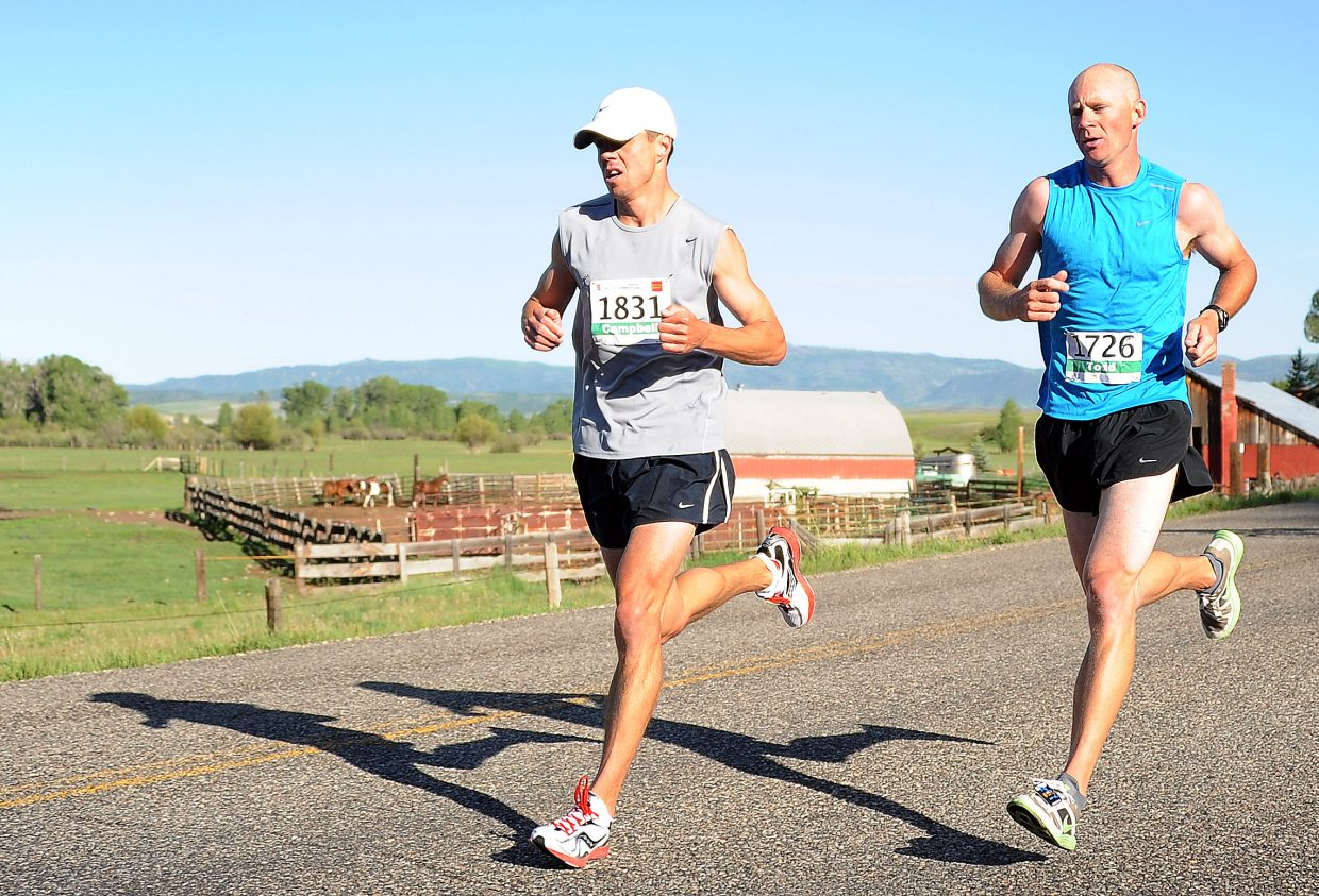 Campbell Ilfrey, left, and Craig's Todd Trapp match each other step for step Sunday during the half-marathon race of the Steamboat Marathon. Ilfrey eventually pulled away for a narrow win. Trapp was second.
