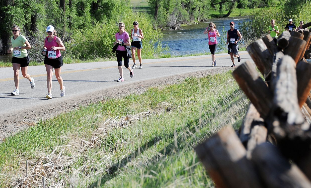 Runners head up and away from the Elk River on Sunday during the Steamboat Marathon.