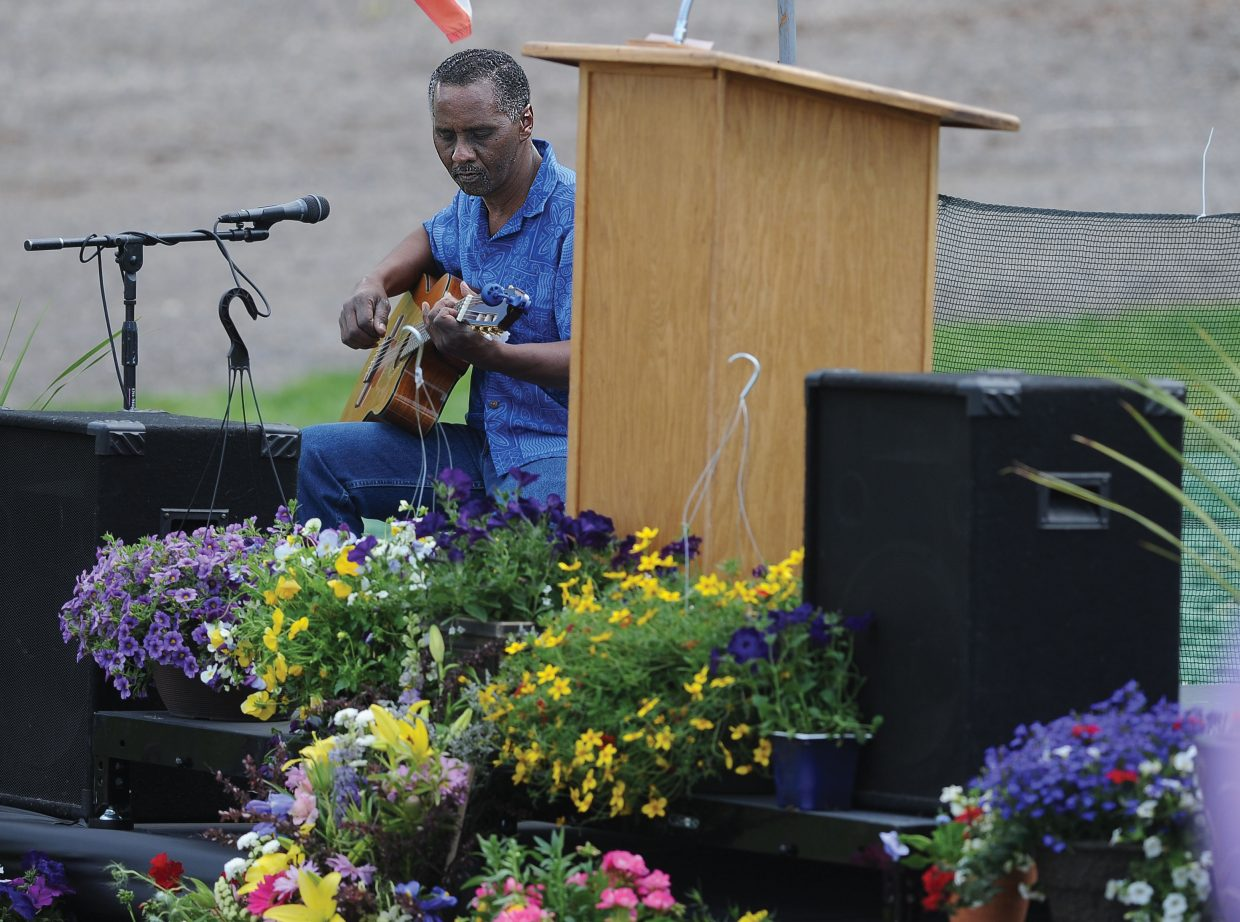 Neil Marchman plays the guitar at a memorial for Asher Lesyshen-Kirlan on Monday afternoon at the base of Howelsen Hill. Marchman was Lesyshen-Kirlan's guitar teacher.