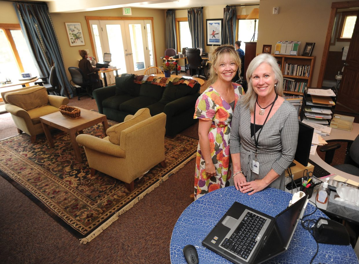 Katy Thiel and Vicki Barron, co-directors of the hospice program in Steamboat Springs, stand inside the offices of the hospice staff at Rollingstone Respite House. The Northwest Colorado Visiting Nurse Association will mark 20 years of providing hospice services in the Yampa Valley with its annual Hospice Celebration of Life event Monday, June 10. The organization has enjoyed steady growth since its inception and recently moved its offices to the Rollingstone Respite House, with plans to make the house more accessible for patients and their families.