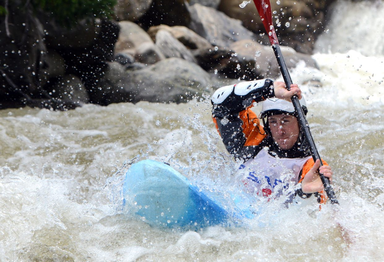 Marty Smith bobs down Fish Creek on Monday.